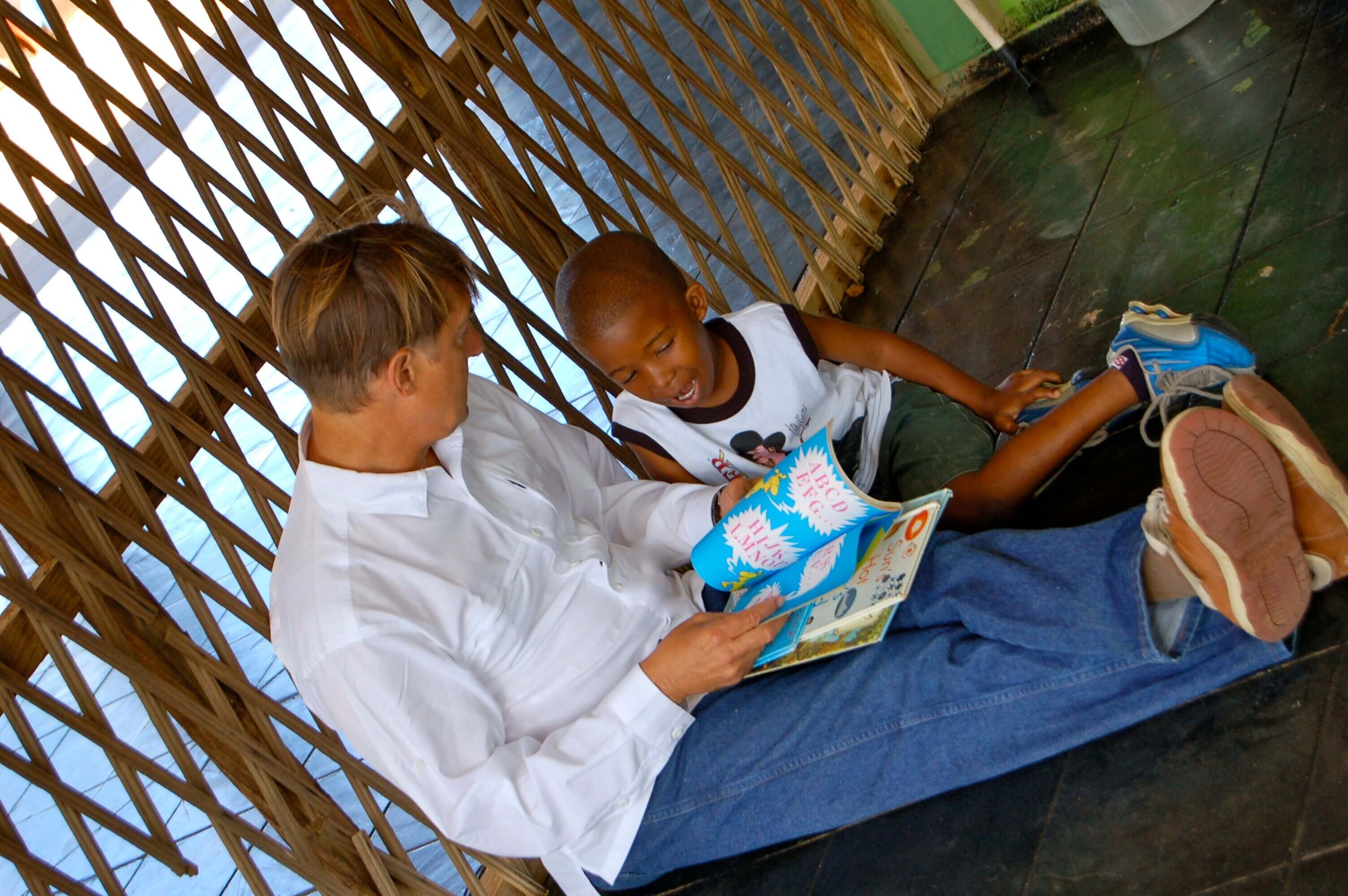 Dr. Grauer reading to an orphan in Botswana